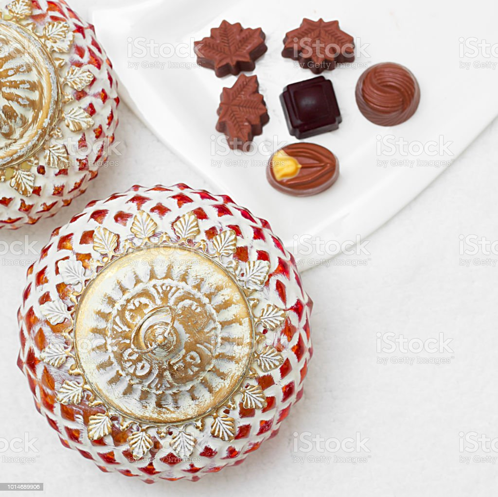 Eid Mubarak greeting with Eid Al Adha sacrifice festival, Islamic Arabic candle and sweet chocolate sugar stock photo