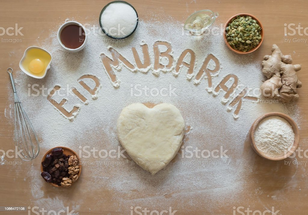 Eid Mubarak - Islamic holiday welcome phrase ' happy holiday', greeting reserved. Arabic cuisine background. stock photo