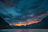 Eidfjord, Hordaland County, Hardanger Region, Hardangerfjord, Norway. Amazing Sunset Sunrise Sky Above Summer Scenic View Of Hardangerfjord Fjord. Famous Norwegian Landmark And Popular Destination.