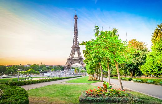 Paris Eiffel Tower and Trocadero garden at sunrise in Paris, France. Web banner format. Eiffel Tower is one of the most iconic landmarks of Paris at early morning