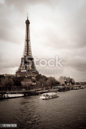 istock Eiffel Tower and Bateaux-mouches, Paris, desatured effect, vertical. 157567629