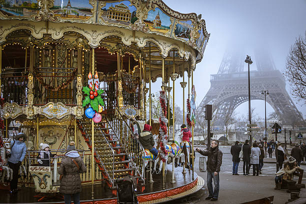 eiffel tower and carousel - nzgmw2017 stock pictures, royalty-free photos & images