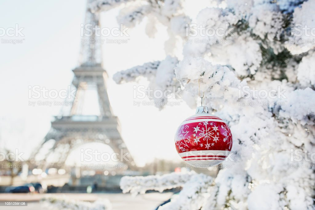 Eiffel tower and Christmas tree covered with snow in Paris stock photo
