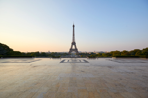 Eiffel tower and empty Trocadero square, nobody in a clear summer morning in Paris, France