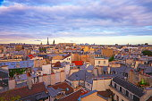 Eiffel Tower and french roofs architecture from above at dawn – Paris, France