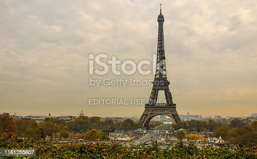 Eiffel Tower and Paris cityscape seen from Jardins de Trocadero during sunset in autumn, Paris, France