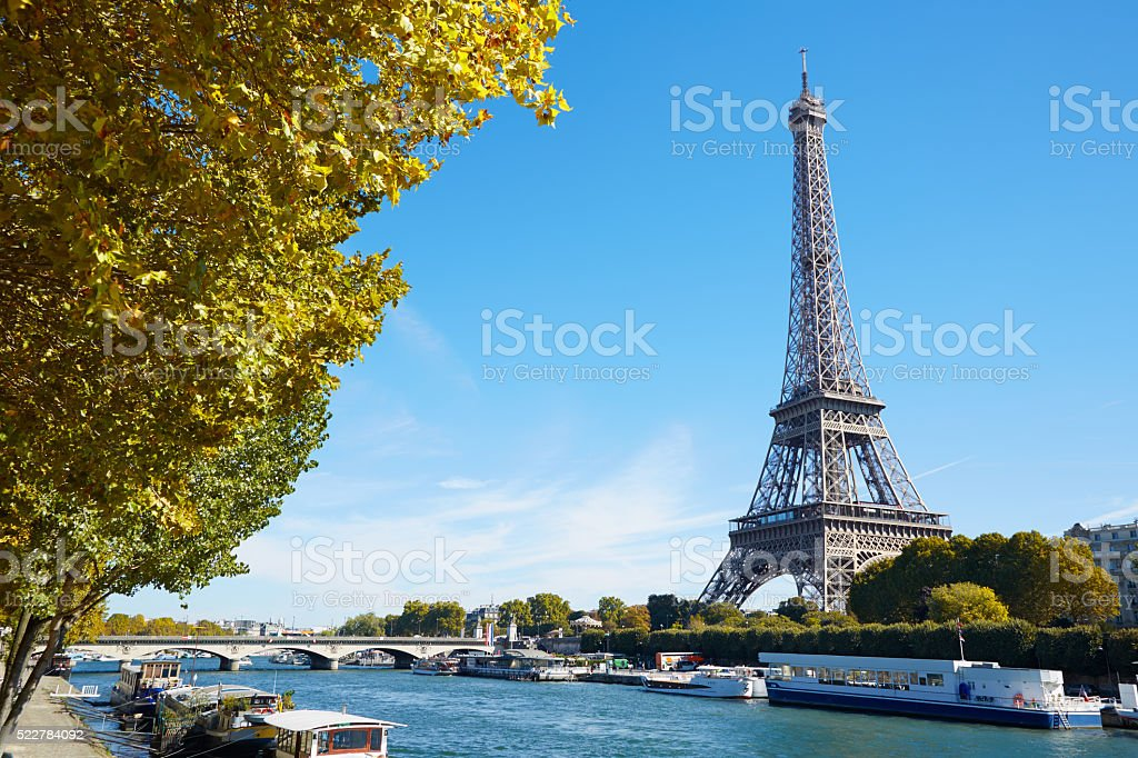 Eiffel tower and river view with autumn trees in Paris stock photo