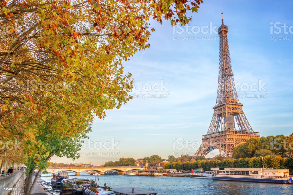 Eiffel tower and the river Seine, yellow automnal trees, Paris France royalty-free stock photo