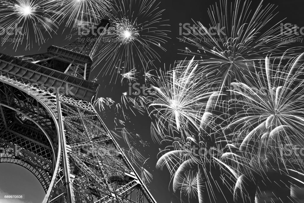Eiffel tower at night with fireworks, french celebration and party, black and white image, Paris France - Photo