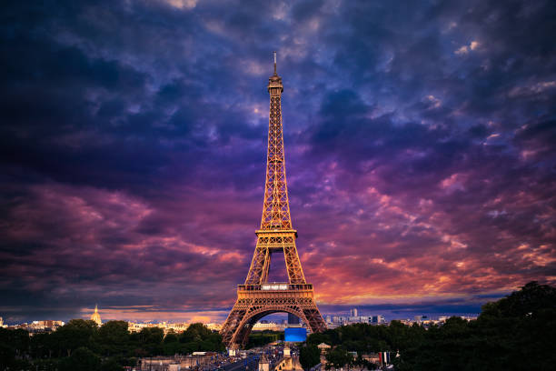 eiffel tower at sunset paris france - eiffel tower stock photos and pictures