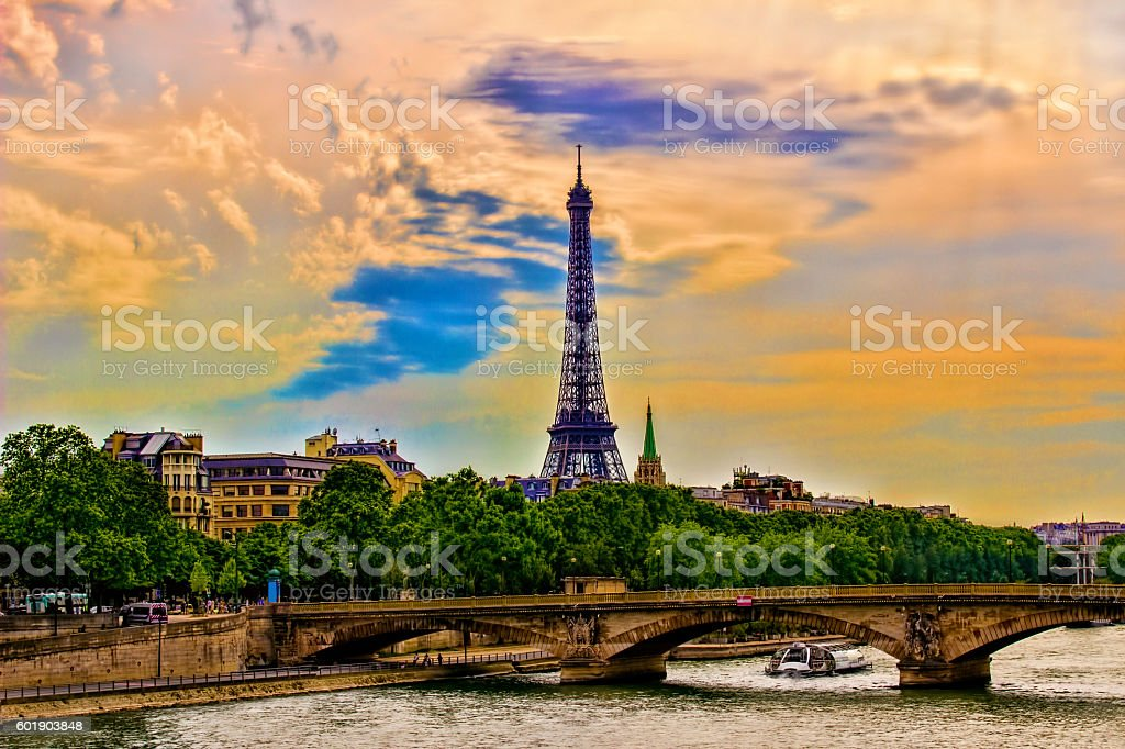 Eiffel Tower at sunset under cloudy sky in Paris, France stock photo