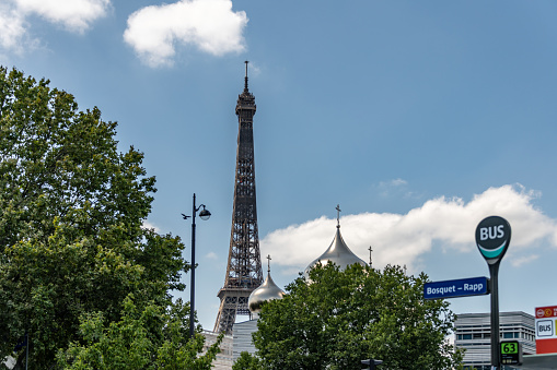 Eiffel Tower behind a bus stop for Bosquet - Rapp