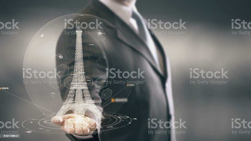 Eiffel Tower Businessman holding in Hand Landmark New technologies stock photo
