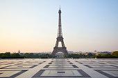 Eiffel tower, empty Trocadero, nobody in a clear summer morning in Paris, France