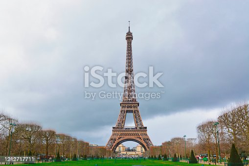 The eiffel tower in Paris, France from a long distance on a summer day.