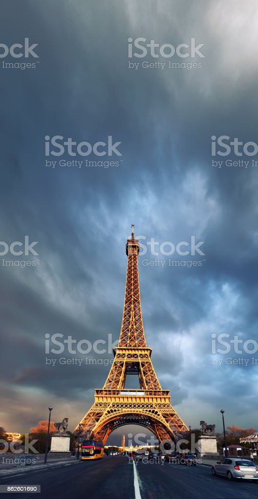 Eiffel Tower on a stormy evening reflecting  the last rays of setting Sun, space stock photo