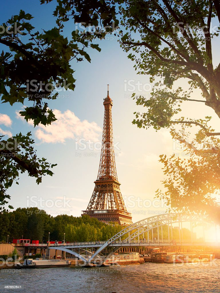 Eiffel Tower on the bank of river seine at sunset royalty-free stock photo