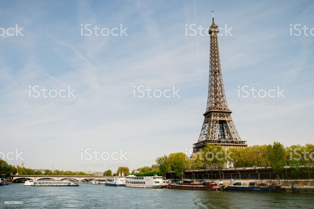 Eiffel Tower on the left bank of the Seine river in Paris stock photo
