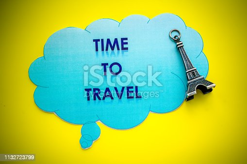 istock Eiffel Tower on yellow background. Miniature concept.Welcome to France. yellow background. Europe travel landmark and famous travel place. World traveling concept. small eiffel tower. The Adventure Awaits life style 1132723799