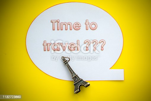 istock Eiffel Tower on yellow background. Miniature concept.Welcome to France. yellow background. Europe travel landmark and famous travel place. World traveling concept. small eiffel tower. The Adventure Awaits life style 1132723860