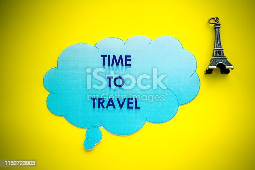 istock Eiffel Tower on yellow background. Miniature concept.Welcome to France. yellow background. Europe travel landmark and famous travel place. World traveling concept. small eiffel tower. The Adventure Awaits life style 1132723903