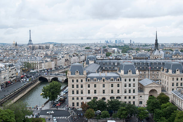 Eiffel Tower over Parisian roofs, and Seine river
