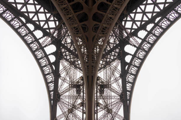 eiffel tower, paris, details of a pillar - filigree stock photos and pictures