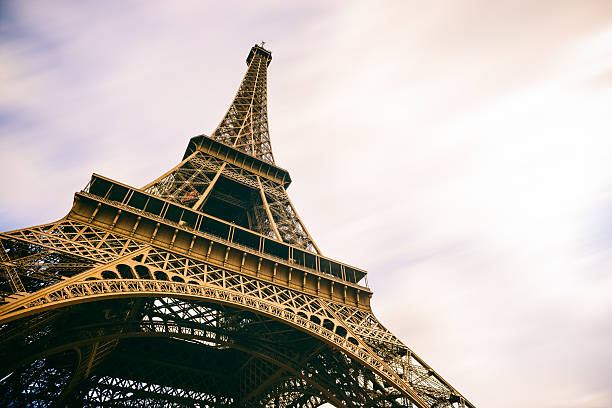 Eiffel Tower Paris France with Moving Clouds stock photo