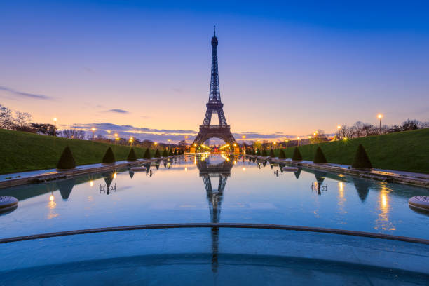 eiffel tower, paris. frozen reflections - eiffel tower stock photos and pictures