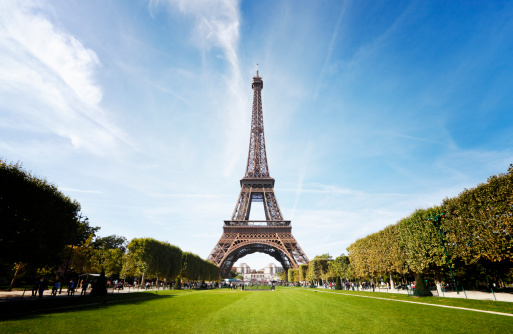Wide angle shot of the Eiffel Tower taken from the Champ de Mars.