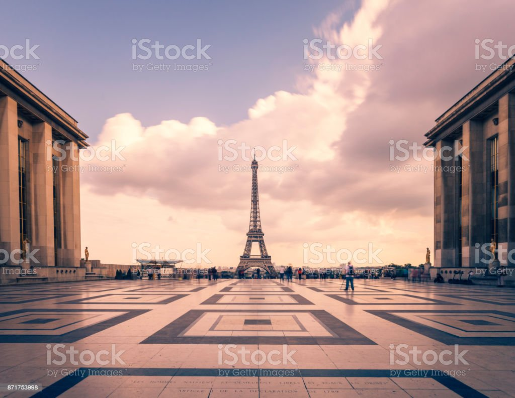 Eiffel tower, Paris symbol and iconic landmark in France, on a cloudy day. Famous touristic places and romantic travel destinations in Europe. Cityscape and tourism concept. Long exposure. Toned stock photo