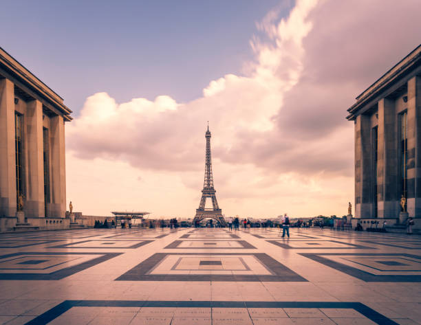 eiffel tower, paris symbol and iconic landmark in france, on a cloudy day. famous touristic places and romantic travel destinations in europe. cityscape and tourism concept. long exposure. toned - paris france stock photos and pictures