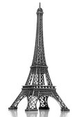 A model Eiffel tower souvenir isolated on white with reflection.