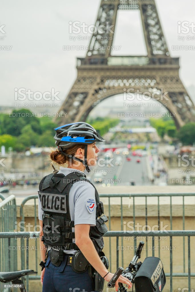 Eiffel Tower Police woman stock photo