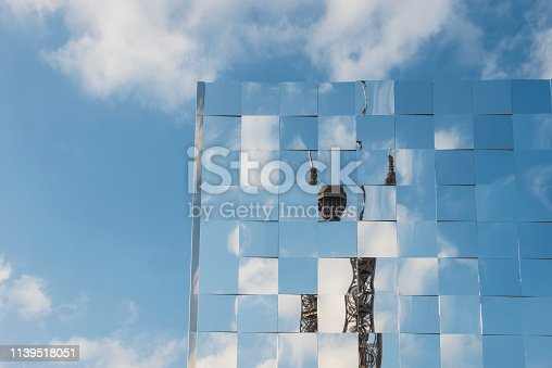 Mirror windows reflecting the sky and the EIffel Tower