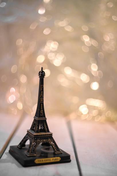 eiffel tower souvenir on a wooden board tourism travel france paris stock photo