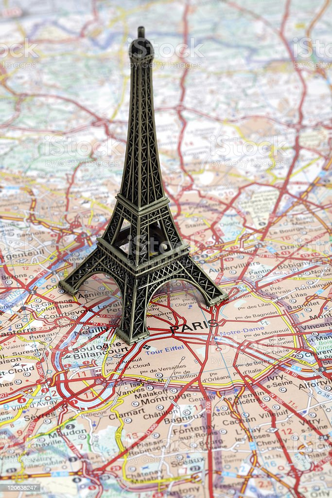 Eiffel Tower statue on a map of Paris royalty-free stock photo