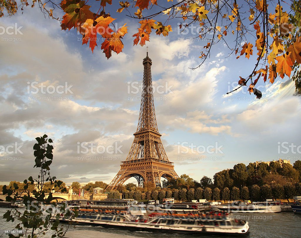 Eiffel Tower with autumn leaves in Paris, France stock photo