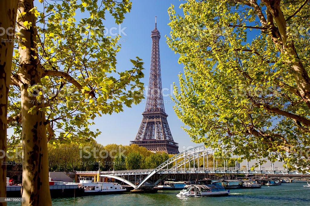 Eiffel Tower with boat  in Paris, france stock photo