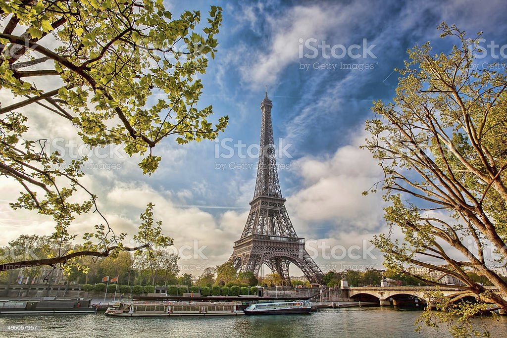 Eiffel Tower with boat on Seine in Paris, France stock photo