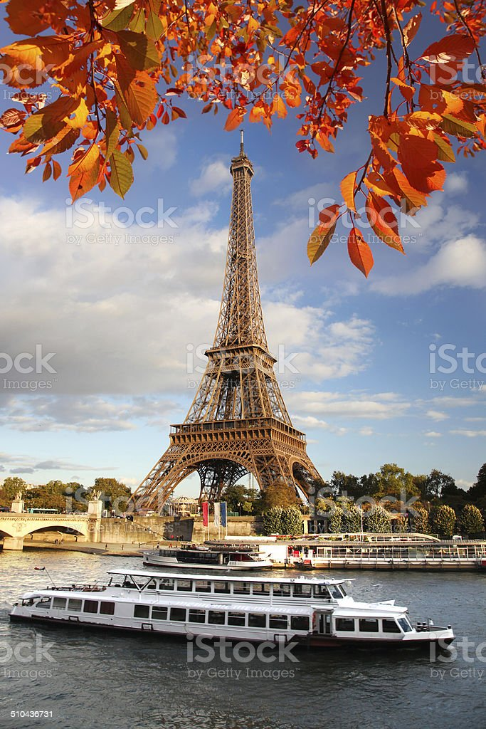 Eiffel Tower with boats on Seine in Paris, France stock photo
