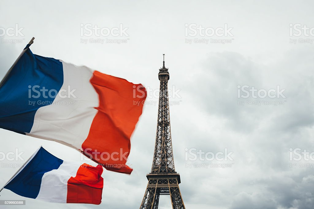 Eiffel Tower With French Flags stock photo
