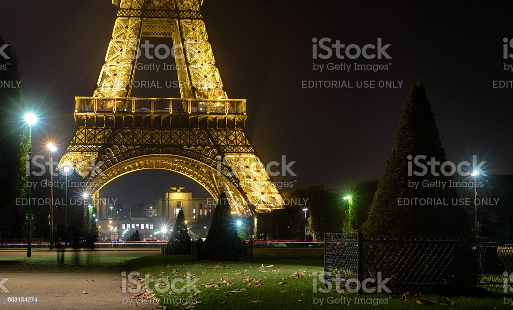 Eiffel tower with golden illumination by night in Paris stock photo