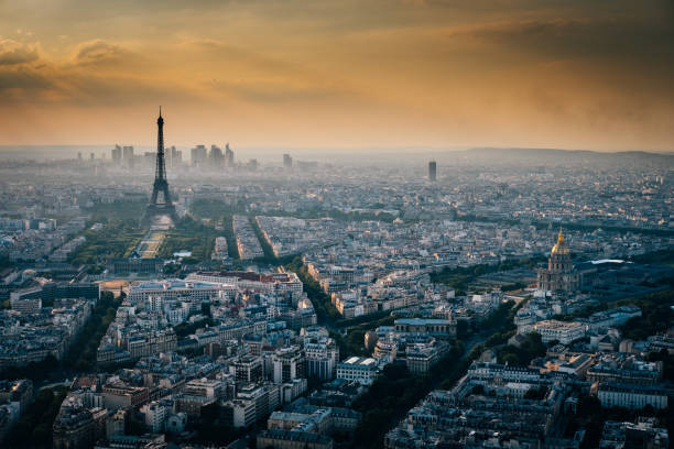 Eiffel tower with Paris aerial view during sunset