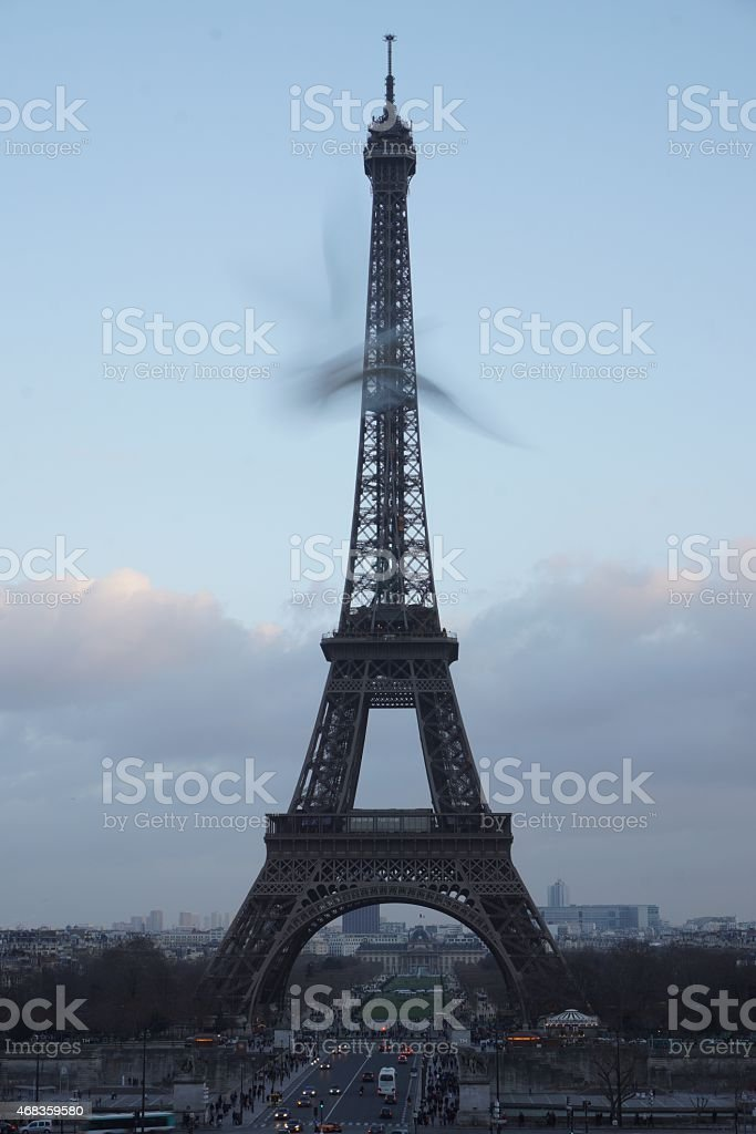 Eiffel Tower with seagull flying by in blur royalty-free stock photo