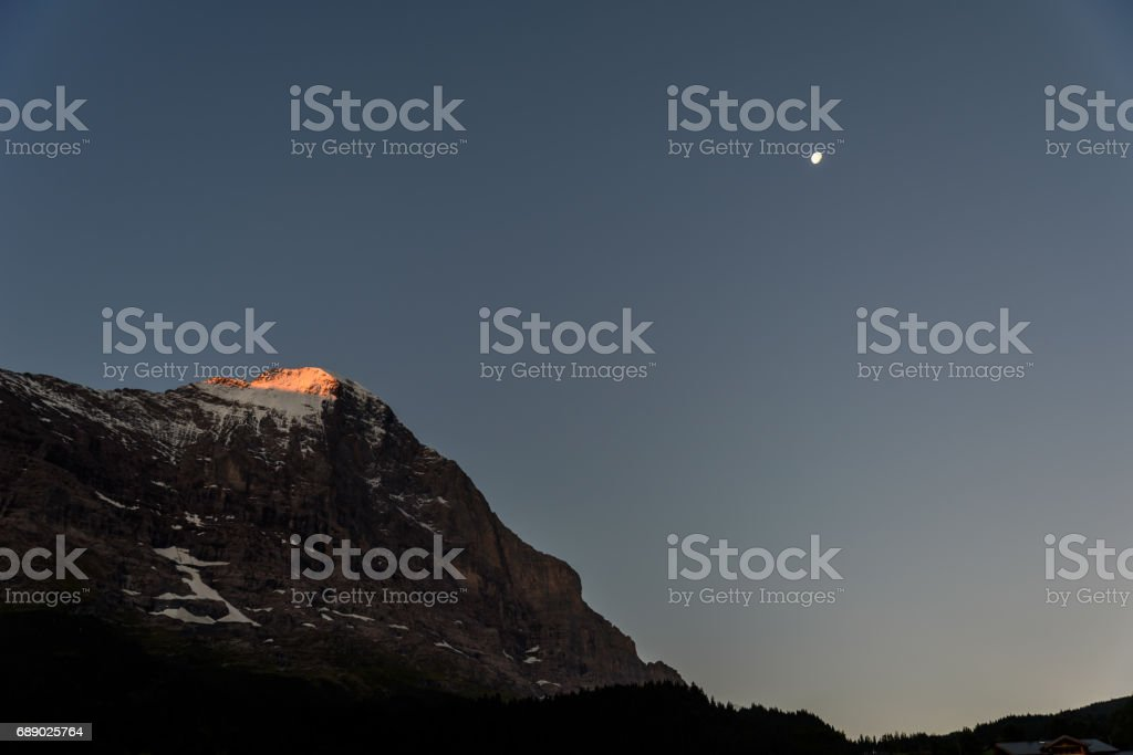 Eiger north wall - view to Eiger from Grindelwald in  in the Bernese Alps in Switzerland stock photo