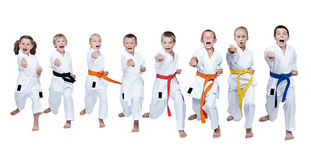 eight athletes in karategi hit punch arm - karate stock photos and pictures