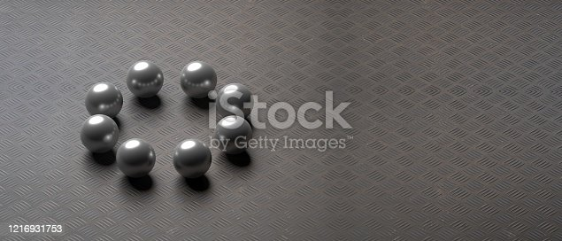 Eight black balls on metal sheet industrial floor background, copy space. 3d illustration