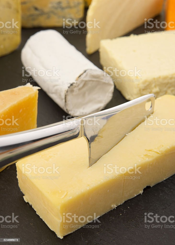 Eight Different British Cheeses On Slate Board With Cheese