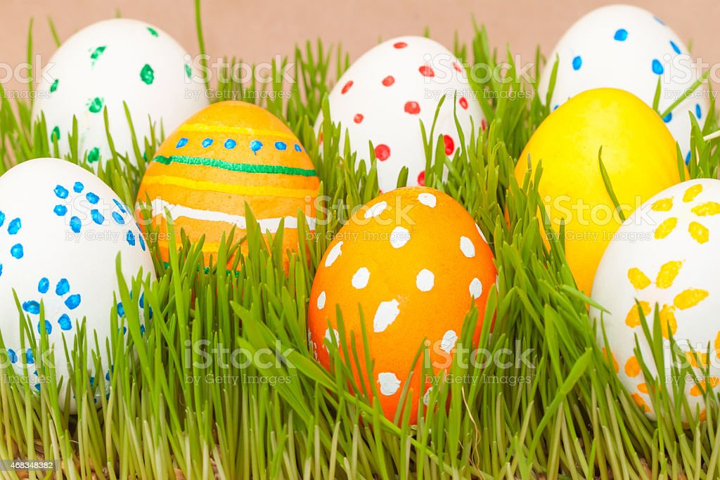 eight easter eggs in spring grass royalty-free stock photo